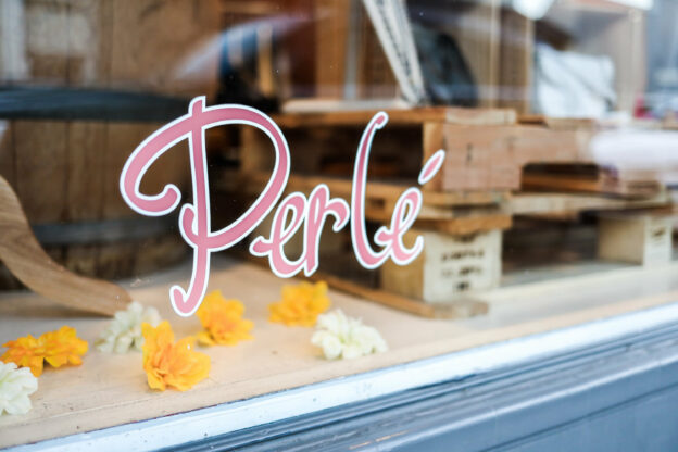 perle store front logo